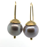 Grey pearl earrings handcrafted by Rebecca Lankford in Houston Heights, Houston, Texas