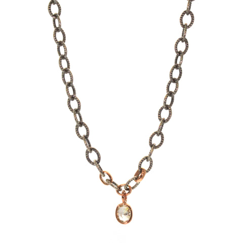 This Chunky Champagne Diamond Necklace was handcrafted at Rebecca Lankford Designs in Houston, Texas. It features a light, oval champagne diamond bezel set in rose gold on a rhodium plated chunky chain with 3 accenting rose gold links.
