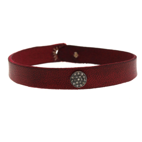 This Red Leather & Diamond Disc Bracelet was hand cut and dyed at Rebecca Lankford Designs in Houston Heights.