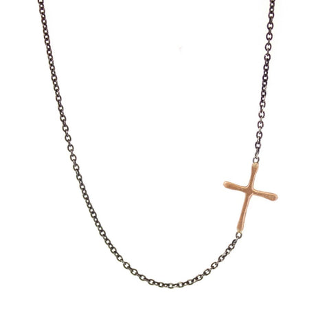 This Sideways Gold Cross is a simple RLD classic. Featuring a gold cross soldered sideways into an oxidized silver chain, this necklace is a subtle reminder of faith and a sweet pop of gold