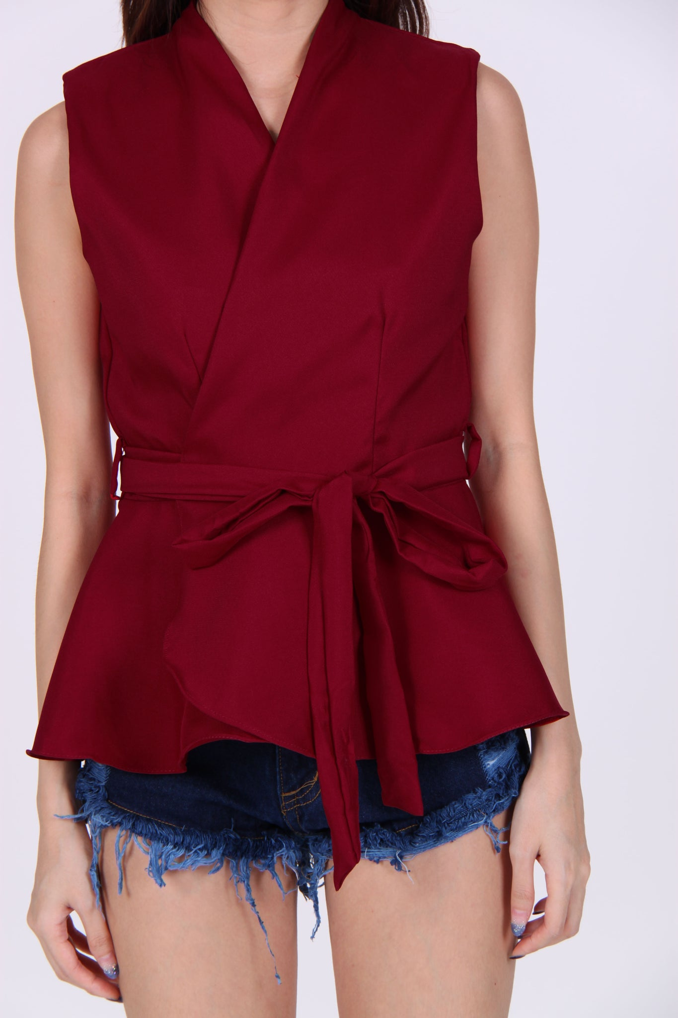 Wrap Peplum Top In Maroon