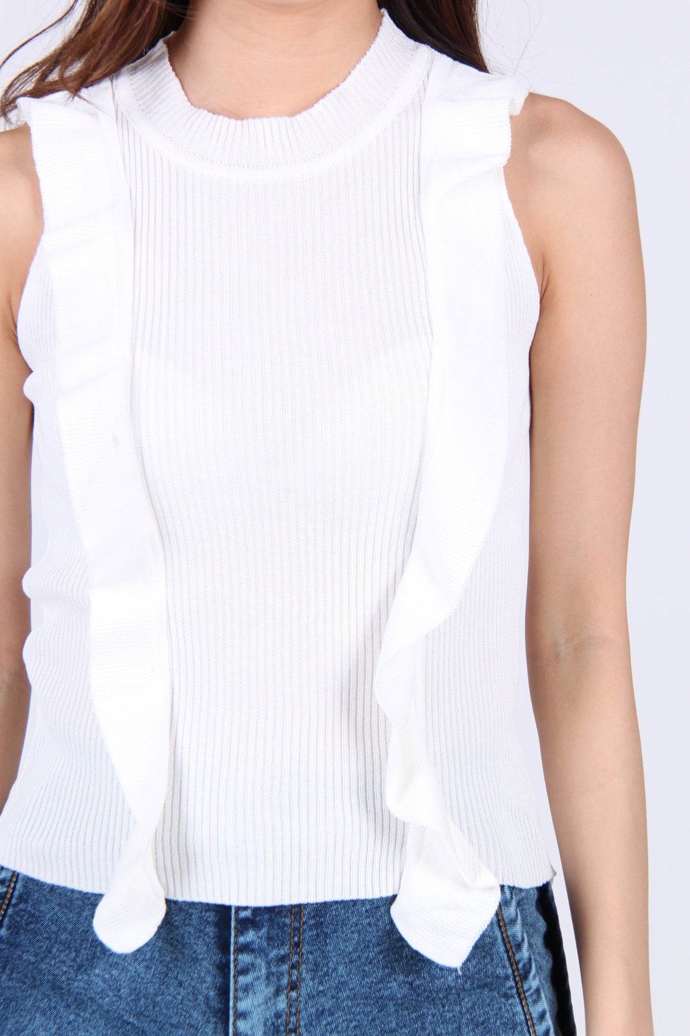Front Ruffles Down Sleeveless Knit Top in White