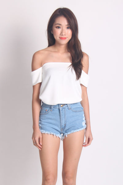 Ripped Denim Shorts With Raw Hem in Light Wash