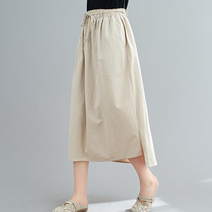 (Pre-Order) Asymmetrical Side Slit High Waist Loose Fit Midi Skirt In Khaki