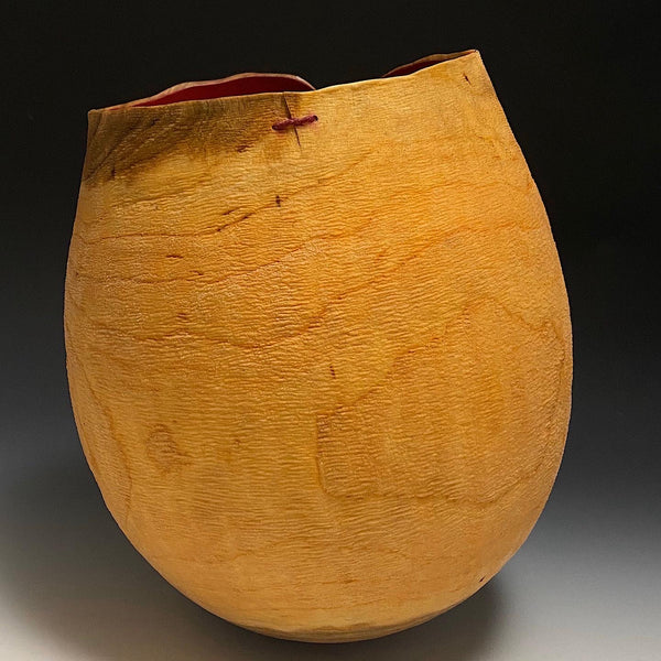 Textured and Sutured Cherry Vessel