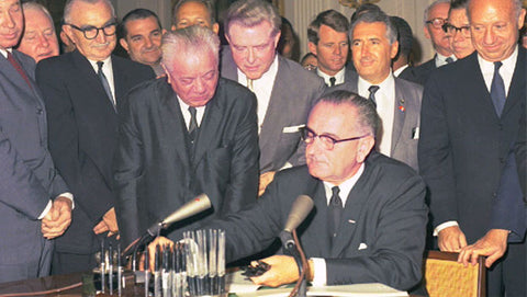 Lyndon B. Johnson signs civil rights act of 1964