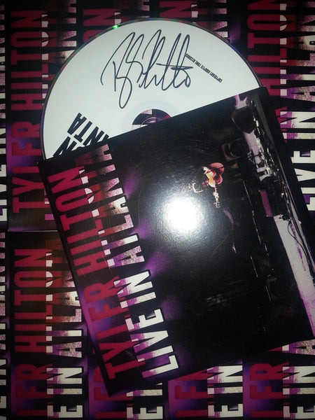 "SIGNED ""LIVE IN ATLANTA"" CD"