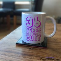 Any Years of Being a Cunt - Pink Personalised Birthday Mug on Coffee Table