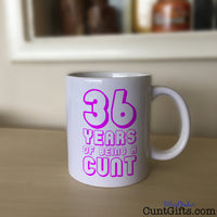 Any Years of Being a Cunt - Pink Personalised Birthday Mug on Sideboard