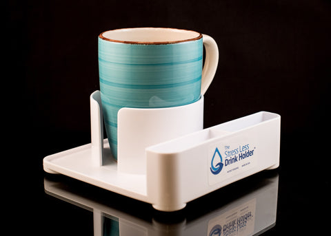 Stress Less Drink Holder holding coffee mug with slots for handles.
