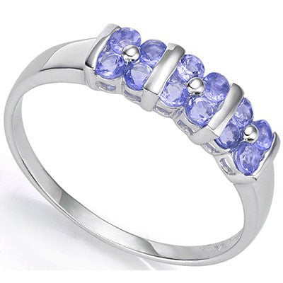 An unusual group of three four petal genuine tanzanite flowers along the band of this sterling silver ring.