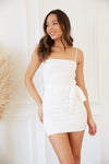 White mini dress with belted waist.
