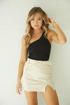 Paradise Belted Mini Skirt in beige.