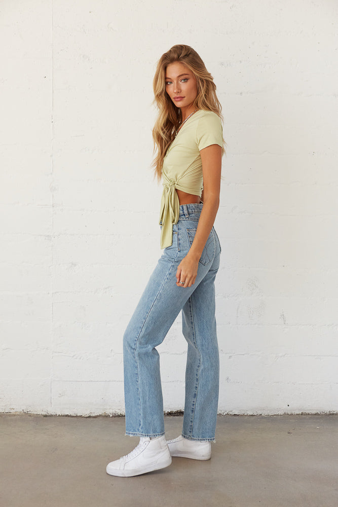 Side view of rollas high rise jeans.