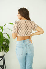 Details of the Lisa Cinched Polka Dot Top.