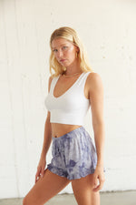 Blue high waisted shorts with ruffle trim.