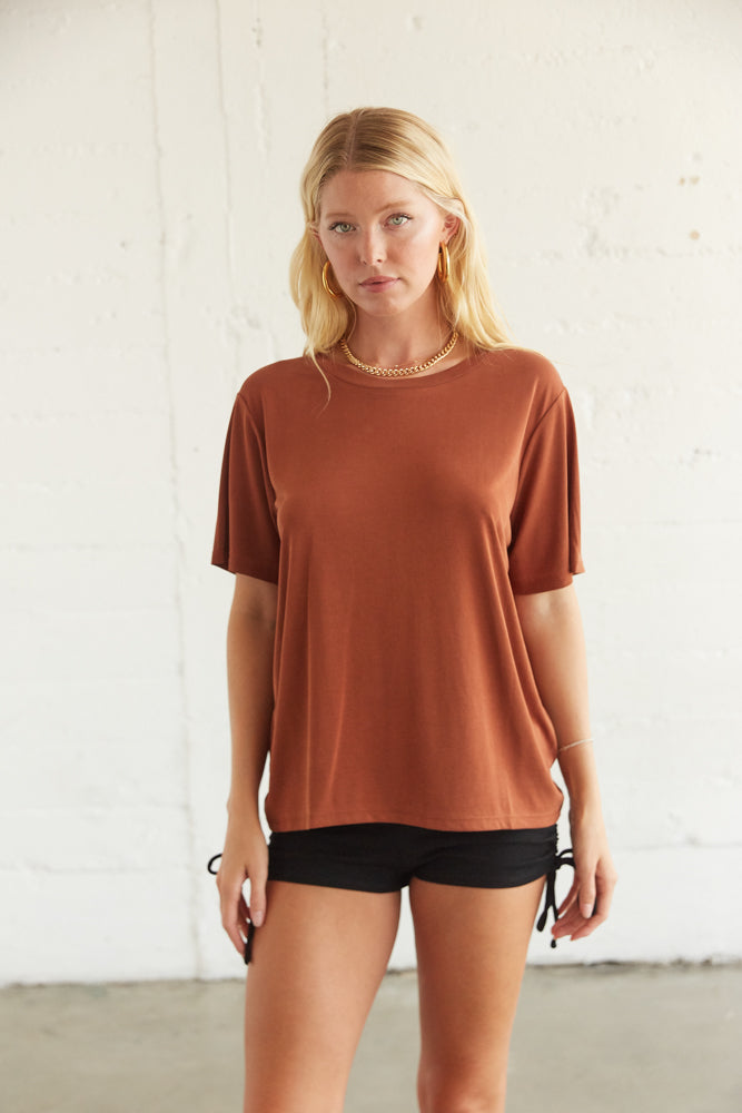 Details of the rust oversized t-shirt.