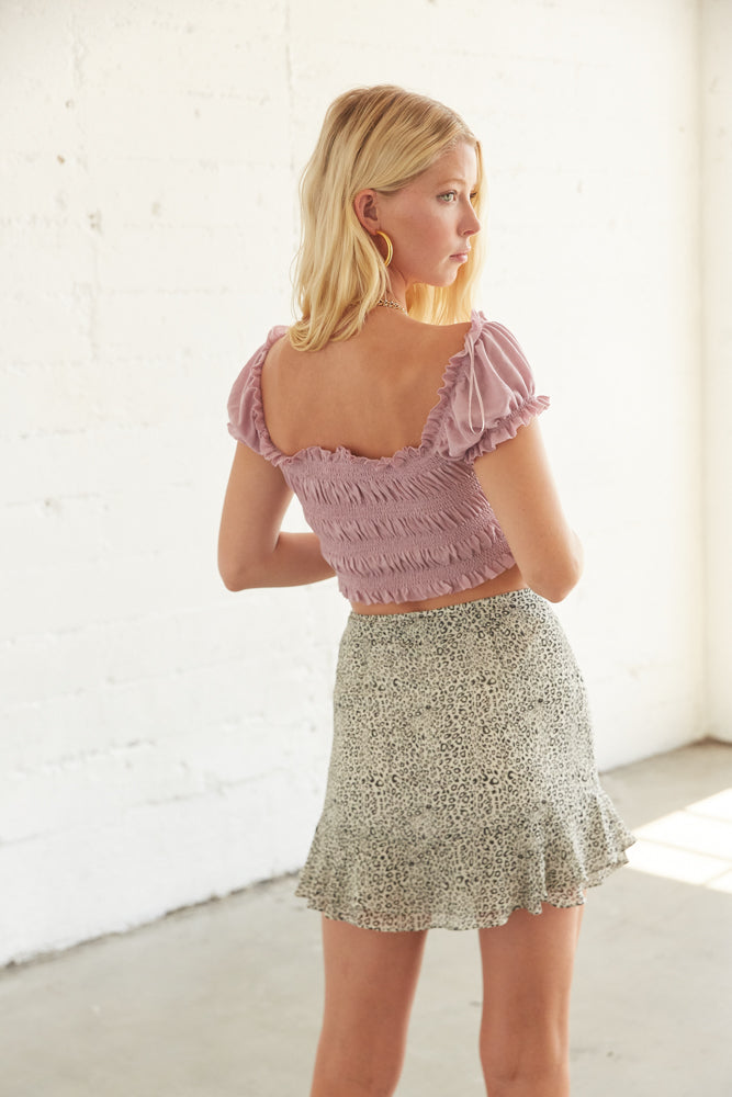 The back of this top is smocked for an easy fit.
