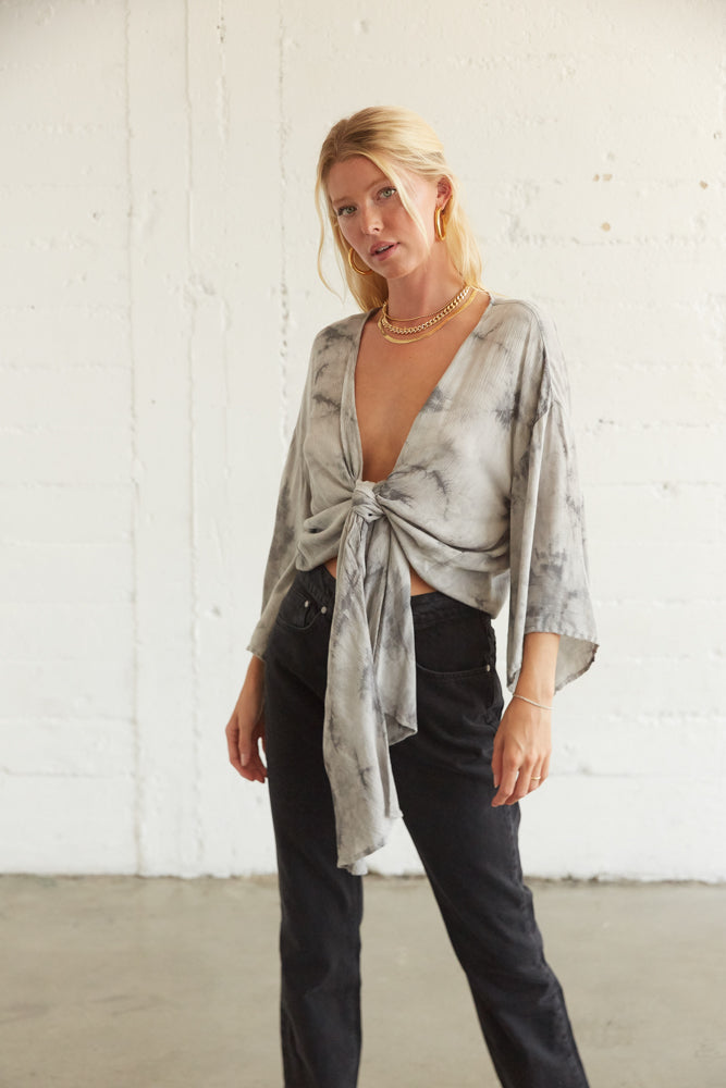 Flowy deep v wrap top with adjustable front tie detail.