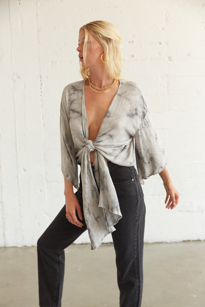 Flowy tie dye crop top with front tie detail.
