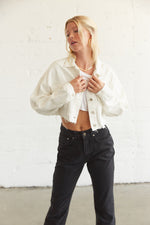Boxy cropped denim jacket in white.
