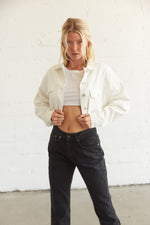 white cropped denim jacket.