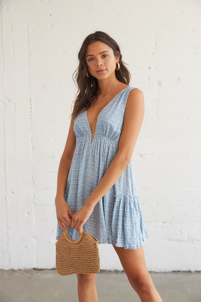 This perfect summer dress is complete with side ruffle detailing for a flirty final touch.