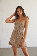 This dress has a cheetah print and adjustable tie straps for the perfect fit.