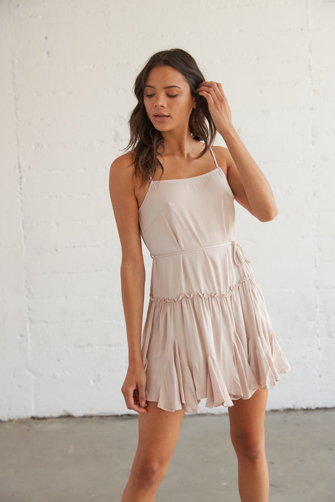 Flowy dress with a ruffle skirt and a tie at the waist.