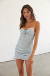 blue mini dress with sweetheart neckline and a ruched body.