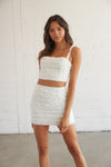 White skirt set with ruffle detailing throughout.