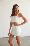 Ruffle tank straps complete this adorable crop top.