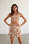 Rust floral crop top with matching high rise skirt.