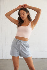 Grey shorts that come with the set.