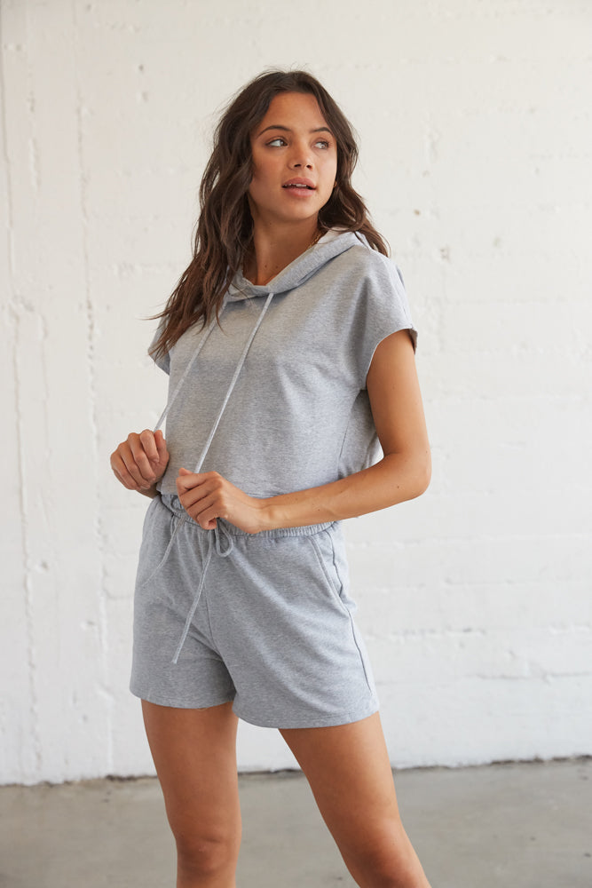 Grey crop hoodie with matching high rise shorts.