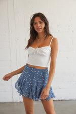 Blue flowy high rise skirt with a dainty floral print.