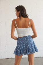 Flowy back of the skirt with subtle pleated detailing.