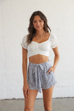 White puff sleeve crop top.