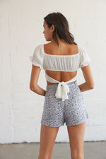 Back of the shorts feature a relaxed fit and a belt detail at the waist.