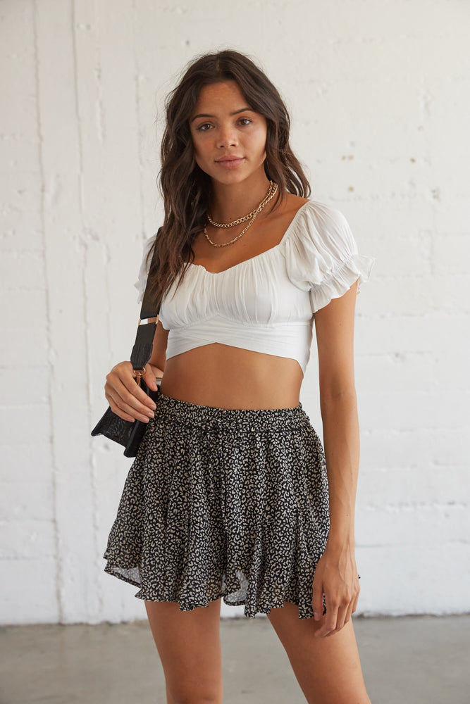 Black and white leopard print flowy shorts with an elastic waistband.