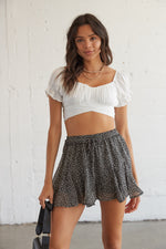 Black and white leopard print shorts.