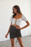 High waisted skirt with side cinched detailing.