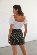 The back of this floral skirt features a ruched design.