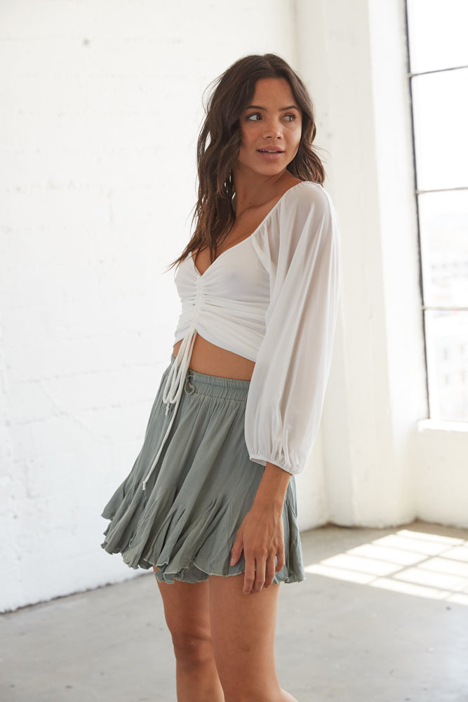 Flowy shorts with a drawstring tie and an elastic waistband.