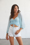 Sky blue crop top with front tie detail.