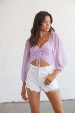 Lilac mesh crop top with front cinched detail.