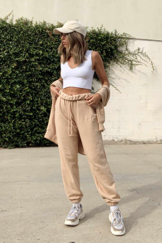 Tan sweatpants with elastic waistband.