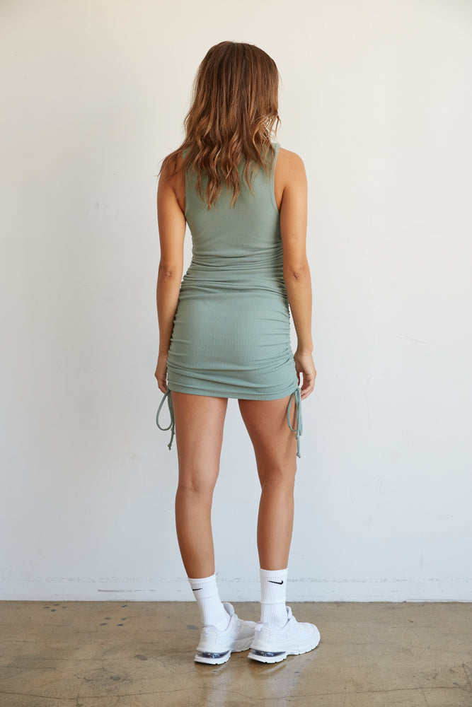 The back of this dress is ruched for the perfect fit.