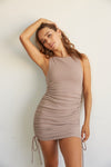 Dusty mauve cinched dress with ruched body.