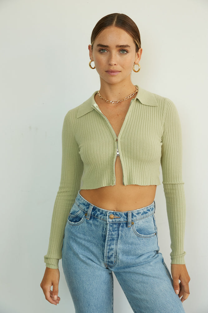 Green cropped zipper sweater.